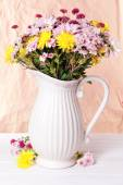 Beautiful flowers in pitcher — Stock Photo
