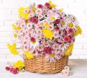 Beautiful flowers in wicker basket — Foto Stock