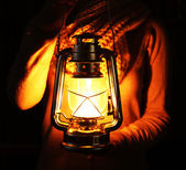 Lantern in hands in darkness — Stock Photo