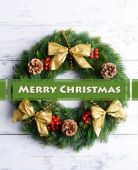 Christmas decorative wreath with leafs of mistletoe on wooden background — Stock Photo
