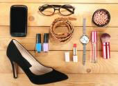 Essentials fashion woman objects on wooden background — Stock Photo
