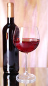 Red wine glass and bottle — Стоковое фото