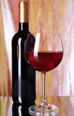 Red wine glass and bottle — Stock Photo