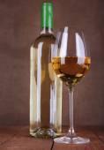 Wine bottle and wineglass — Stock Photo