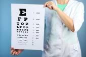 Woman with eye chart — Stock Photo