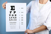 Woman with eye chart — Stock Photo