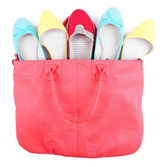 Women bag with shoes top view isolated on white — Stock Photo
