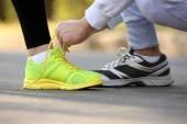 Runner's feet on road — Stock Photo