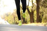 Runner's feet on road — Zdjęcie stockowe