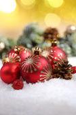 Christmas balls on snow — Stock Photo