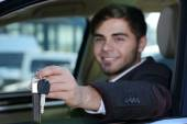 Young man in car — Stock Photo