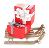 Toy sledge with Christmas gifts — Stock Photo