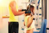 Young girl and trainer in gym — Foto de Stock