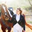 Beautiful girl with horse outdoors — Stock Photo #60833469