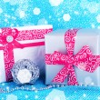 Christmas gift boxes decorated with red ribbon on blue fabric background — Stock Photo #60834101