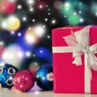 Christmas gift box and decorations on lights background — Stock Photo #60834103
