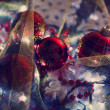 Christmas ornaments and garland on bright background close-up — Stock Photo #60834553