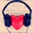 Headphones and heart on wooden background — Stock Photo #60834969