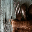 Old tableware wrapped in sackcloth napkin on wooden background — Stock Photo #60835083