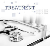 Stethoscope and other things on light background — Foto Stock