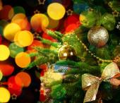 Decorated Christmas tree on festive shiny background — Stock Photo