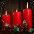 Burning candles on wooden background — Foto de Stock   #60841417