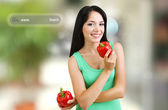 Shopping concept. Girl with fresh peppers on shop background — Stock Photo