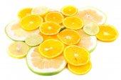 Sliced citrus isolated on white close up — Stock Photo