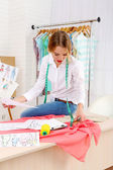 Beautiful young dressmaker — Stock Photo