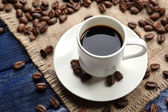 Cup of coffee on wooden table — Stock Photo