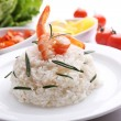 Boiled rice with shrimps served on table, close-up — Stock Photo #60870393