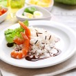 Boiled rice with shrimps served on table, close-up — Stock Photo #60870533