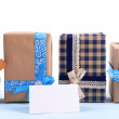 Gift boxes with greeting card on light blue uneven background — Stock Photo #60870743