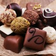 Chocolates assorted on crumble paper — Stockfoto #60872309