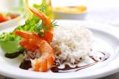 Boiled rice with shrimps served on table, close-up — Stock Photo