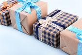 Gift boxes on light blue uneven background — Stock Photo