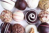 Assortment of chocolates on white background — Stock Photo