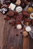 Different chocolates with coffee beans — Stock Photo