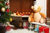 Teddy bear with gifts — Stock Photo