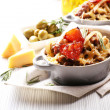 Pasta baked with vegetables and cheese in ceramic pot — Stock Photo #60894595