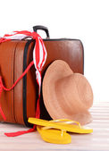 Vintage valise with summer items on wooden board — Stock Photo