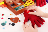 Making of handmade toys from gloves on white background — Stock Photo