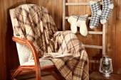 Rocking chair with plaid — Stockfoto
