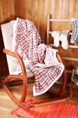 Rocking chair with plaid — Foto Stock