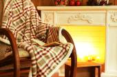 Rocking chair with plaid — Stock Photo