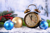 Alarm clock with Christmas decorations — Stock Photo
