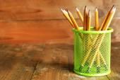 Pencils in metal holder — Stock Photo