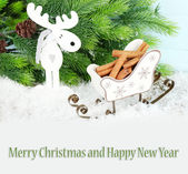 Composition of Christmas decorations on light background as greeting card — 图库照片