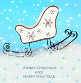 Christmas decoration in shape sled on light blue background as greeting card — 图库照片