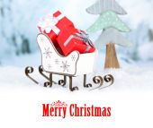 Wooden toy sledge with Christmas gifts on winter background as greeting card — 图库照片